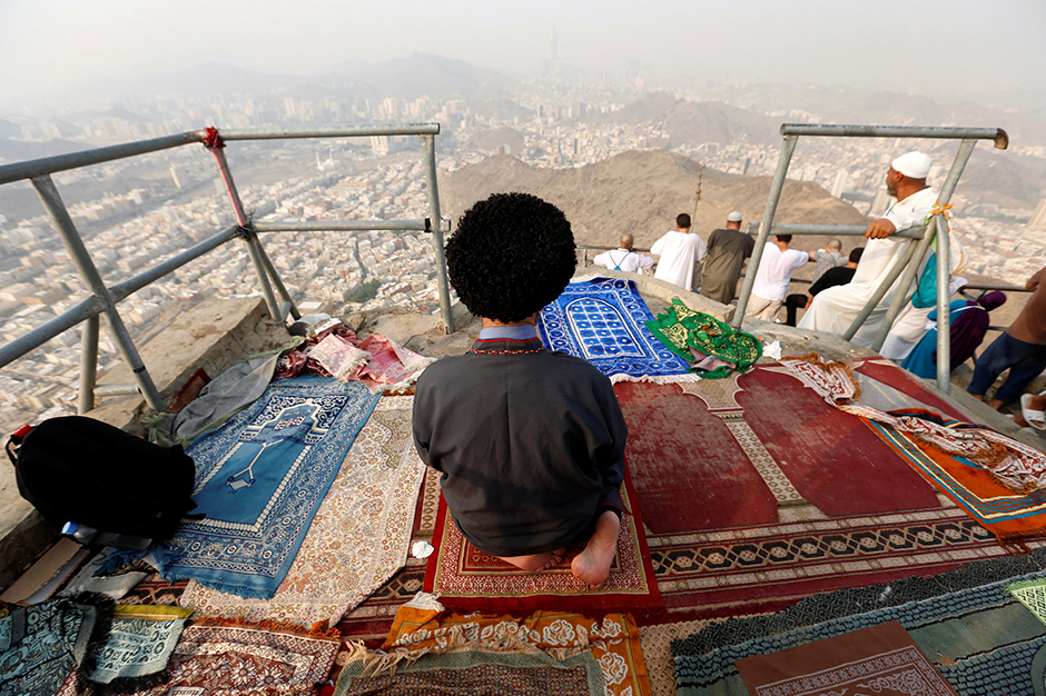 A Muslim pilgrim prays at Mount Al-Noor ahead of the annual haj pilgrimage in the holy city of Mecca